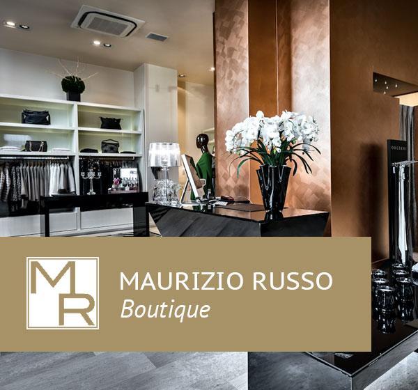 <span>Maurizio Russo</span><i>→</i>